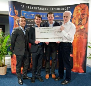 Dr Nick Merriman receives a cheque for £10,000