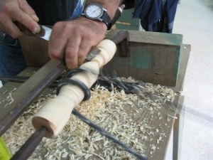 Close-up showing the wood turning